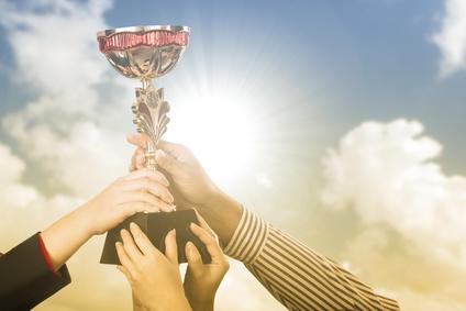 .Businessman team holding award trophy
